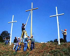 Men from Wyndale Baptist Church repairing cross site.